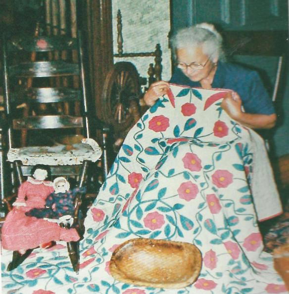 Marjorie inspecting a quilt