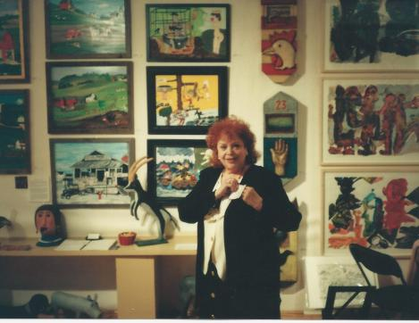 Joy Moos in her display at the 1996 Outsider Art Fain