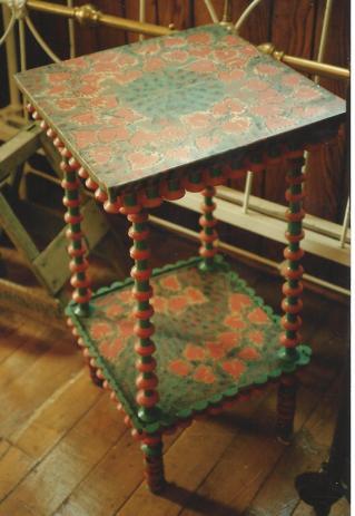 "green and orange ""spool"" table"
